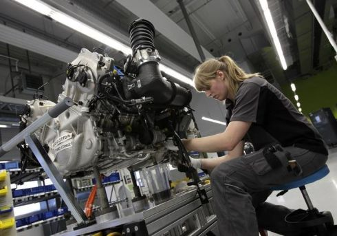 539717-worker-assembles-engine-for-new-porsche-918-spyder-sports-car-at-production-line-of-german-car-manuf